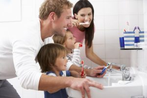 family brushing teeth