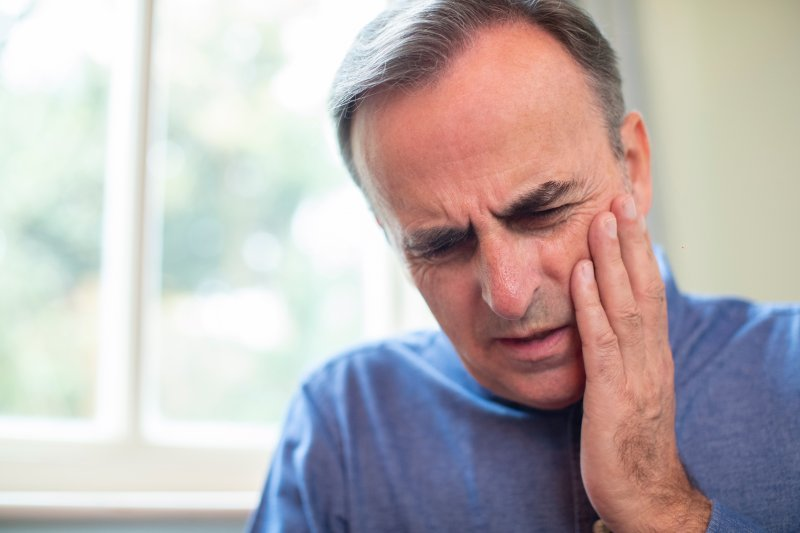 Older man with a toothache in Wayland.